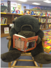 Picture of a gorilla reading a book
